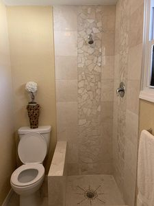 The private bathroom has a marble shower newly remodeled just over a year ago.