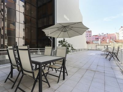 Photo for Huge apartment for 12 guests with terrace near Almirante de Reis avenue