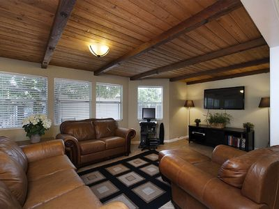 Living Room - with huge flat screen TV and enough seating for the whole family!