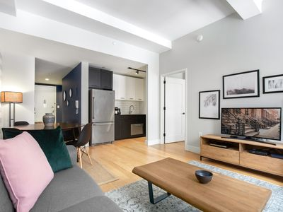 Photo for Bright FiDi 1BR w/ Luxury gym, Doorman, + Rooftop by Blueground