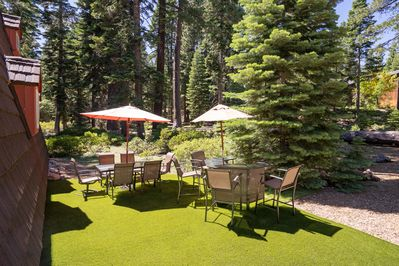 Outdoor summer lounge with newly installed synlawn area