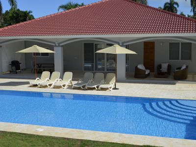 Photo for NEW Hispaniola Fabulous 4 Bedroom Villa 5 Baths Pool Maid AC Walk to Beach Clubs