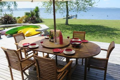 Casual lakeside BBQ area with spa and kayaks inc