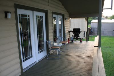 Large and covered front porch - Just sit and watch the river go by