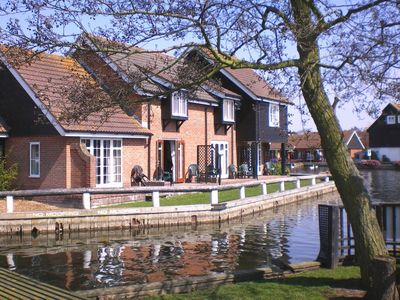 Photo for Romantic Riverside Holiday Cottage At Wroxham, Capital Of The Broads