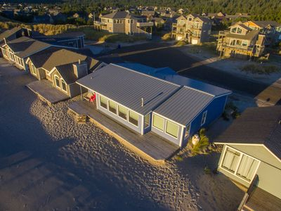 Photo for At Last #112 - Oceanfront home, direct beach access, wall of windows.