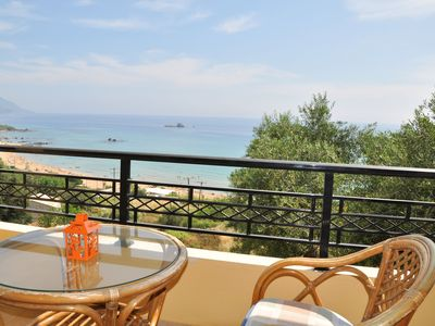 Photo for Lidovois comfortable upper floor apartment with great seaview on Pelekas Beach.