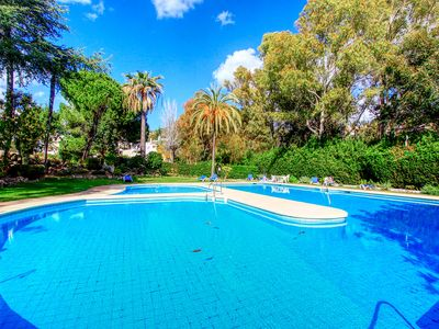 Photo for 1127 modern golf apartment heated pool 3 pools Nueva Andalucia