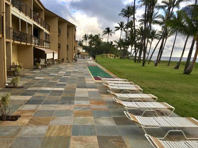 Ground floor lanai replaced in 2016 with beautiful quartzite & new shuffleboard.