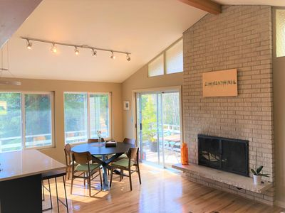 Open living, dining, kitchen with vaulted ceiling