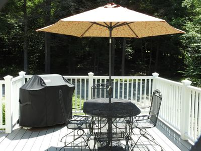 Spacious deck for grilling and dining outdoors.