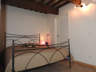 Photo for Romantic apartment in the center, with parking and private courtyard
