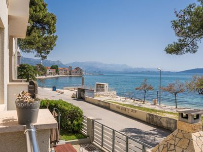 Photo for Modern & freshly decorated apartment with a balcony,  just steps from the beach