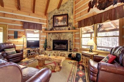 Main level has cathedral ceiling and open family room with great views!