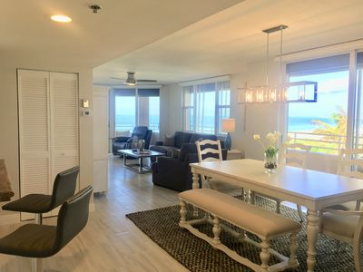 The open floor plan of this luxurious 3-bedroom condo has beautiful ocean views.