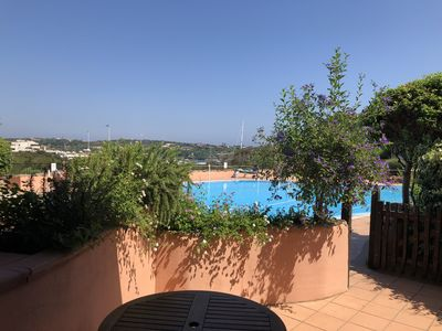 Photo for Nice apartment with private patio by the pool Residence Rocce del porto