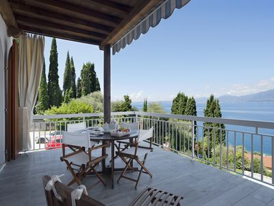 """Photo for Holiday Apartment """"Romantic Big Terrace"""" next to Lake Garda with Lake View, Mountain View, Wi-Fi & Terrace; Parking Available"""