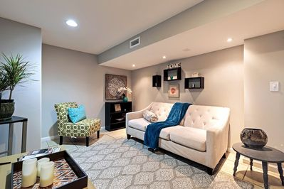 cozy living area with Roku 4k tv/ surround bar and DVD player