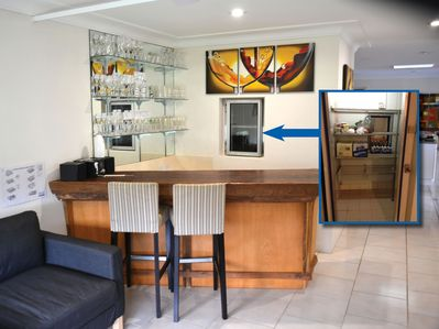 Bar area with sink and access door to coolroom