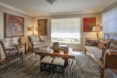 Living room has views of park and lots of natural light