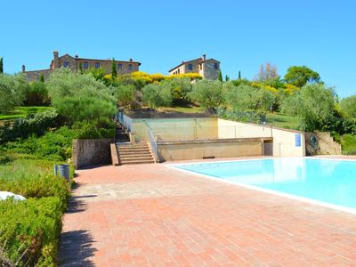Photo for Asciano apartment in the village of Asciano with 2 pools in the hills of Siena