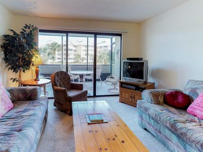 Photo for NEW LISTING! Waterfront condo w/pools, tennis courts, a fitness center & marina
