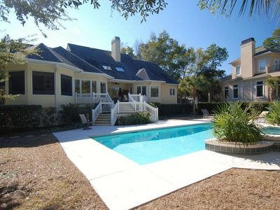 Photo for 7 bedroom, 5 ½ bath luxurious southern style home is situated in Palmetto Dunes, close to Shelter C