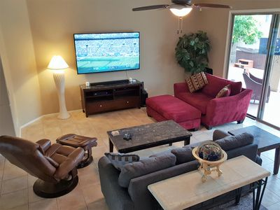 """Family room comfortably seats (6) with 75"""" Smart TV, HBO,  DVR & Samsung sound"""
