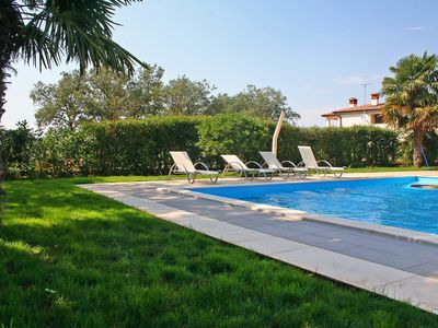 Photo for This 4-bedroom villa for up to 8 guests is located in Porec and has a private swimming pool, air-con