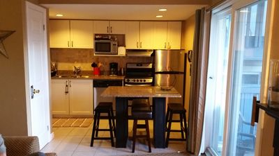 Fridge, stove, dishwasher, microwave, kettle, toaster, dishes & cookware.