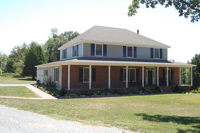 Front and side view of Southern Charm and 2 car garage