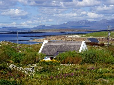 Photo for Traditional thatched cottage, completely renovated, with outlook over the rugged South Connema…