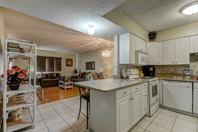 Spacious, open-concept living/dining area.