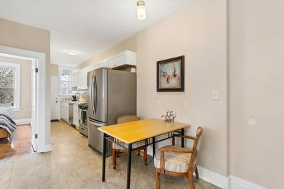 Beautiful kitchen with new stainless steel appliances and quartz countertop.