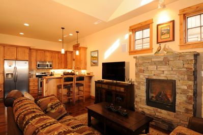 Living room with a cozy fireplace and flat screen TV.