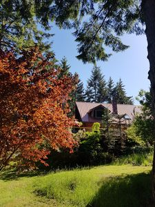 Photo for Large log house on a forest lot, vaulted ceilings, stained glass, french doors.