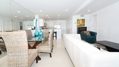 Photo for 1st floor beachfront!!  Steps from the beach! Enjoy 2 pools and jacuzzi. Pet Friendly