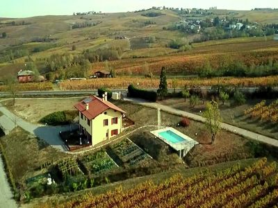 Photo for Among hills and vineyards, apartment in villa with swimming pool and terrace