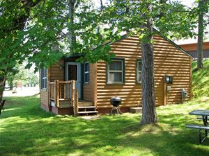 Photo for Charming 2 bedroom lakeside cabin - just feet from waters edge!