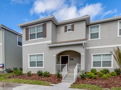 Photo for 4811LL Amazing 5 Bedroom 4  Bathroom Storey Lake Townhome  Only 8 Minutes To Disney