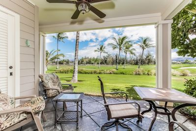 Lanai with table and golf course view