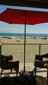 Photo for OCEANFRONT right on the board walk and the sand