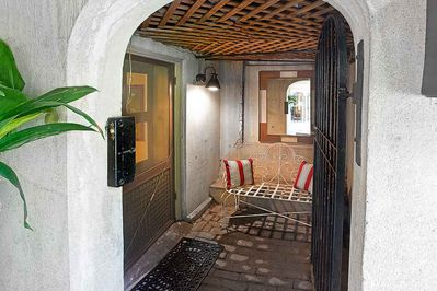 The cute front alcove to the home.