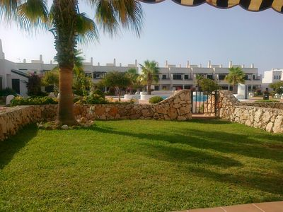 Photo for Apartment with terrace and private garden, complex beautiful gardens and pools