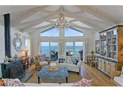 Enter to a shabby-chic livingroom featuring cathedral ceilings.Opens to top deck