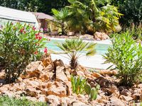 What a lovely holiday home set in beutiful gardens with an inviting pool area and jacuzzi