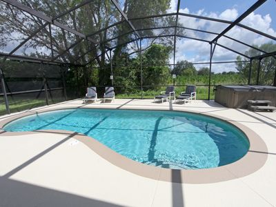 Photo for Pool, games room, 3 miles to Disney, family friendly, huge deck, local manager