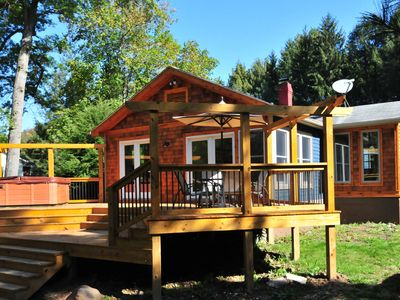 Photo for Captivating 2 Bedroom cottage with hot tub offers amazing river access!