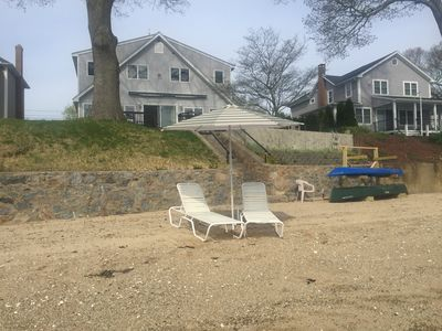 Waterfront home with private sandy beach on Niantic River.