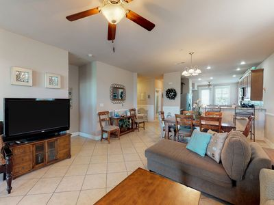 Photo for Oceanside, dog-friendly condo w/ shared hot tub, pools, gym - close to the beach